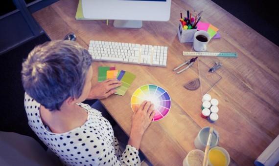 Interior designer working at desk | Custom Carpet Centers