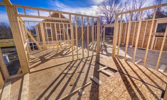 New house framing construction | Custom Carpet Centers
