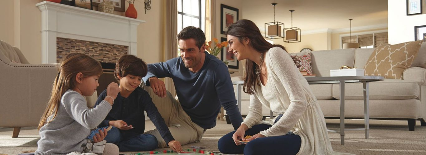 Family enjoying on Carpet | Custom Carpet Centers